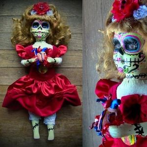Glow in Dark Day of Dead holding real heart doll